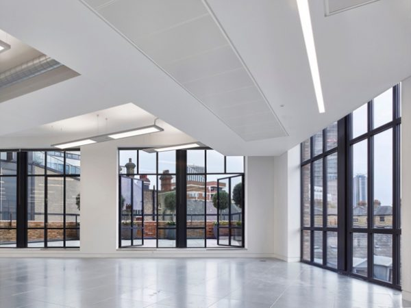 french doors opening onto courtyard with trees and views across London in SE1