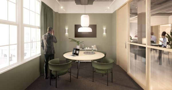 bright meeting room with beige and olive green furniture and fittings in serviced offices on Waterloo Road