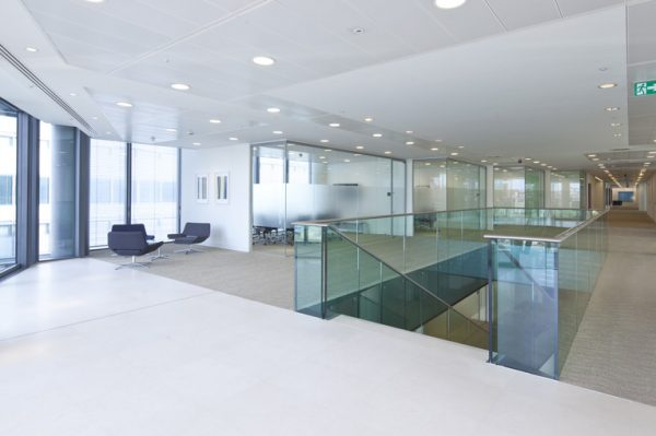 bright leasehold space with small round spotlights in the ceiling and hall and stairs leading downwards