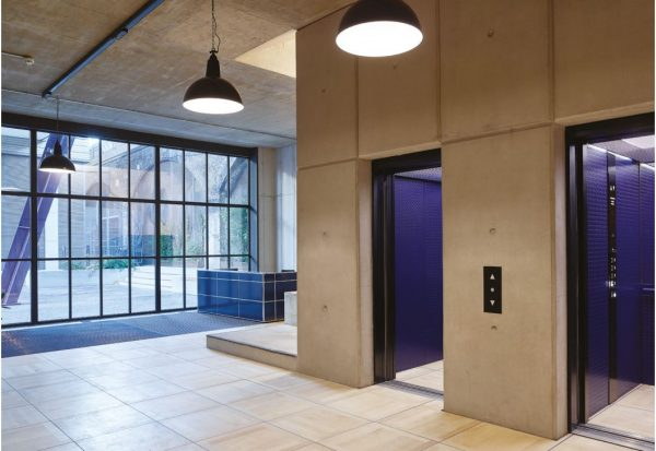 big square tiles into feed into two lifts with controversial purple interiors