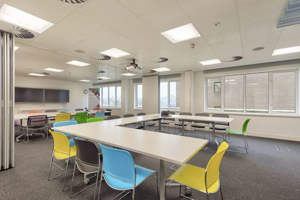 different coloured chairs round u-shaped desks in a meeting room at Shackleton House