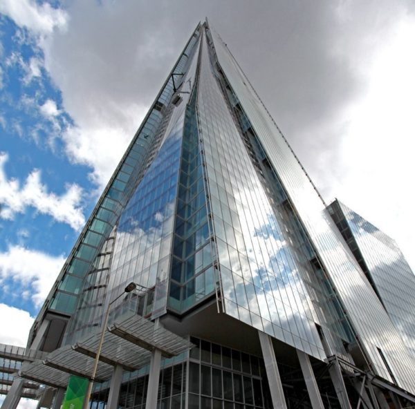 the unique landmark building stretches up into the clouds above London Bridge Street, SE1