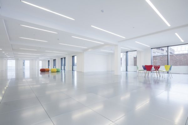 bright and white leasehold office with two circular meeting points of different coloured seats