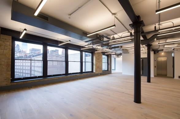 well lit workroom with wooden flooring in Southwark