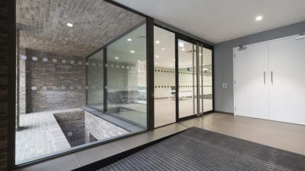 walk in from the outside, a glass double door entrance into the interior of the building