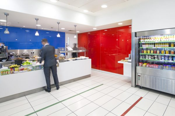 vibrant caferia to grab lunch, fruit, a drink or a snack off the shelves, white tiles, blue and red walls