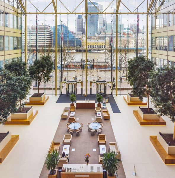 huge open glass lobby boaring views of the Thames and Buildings opposite Cottons Centre