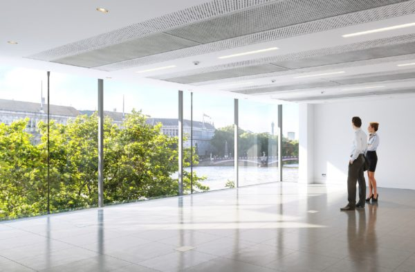 bright office space with floor to ceiling windows looking out onto the Thames in Vauxhall