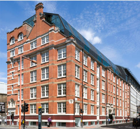front of attractive former warehouse with six levels with beuatiful blue sky above located on Union Street